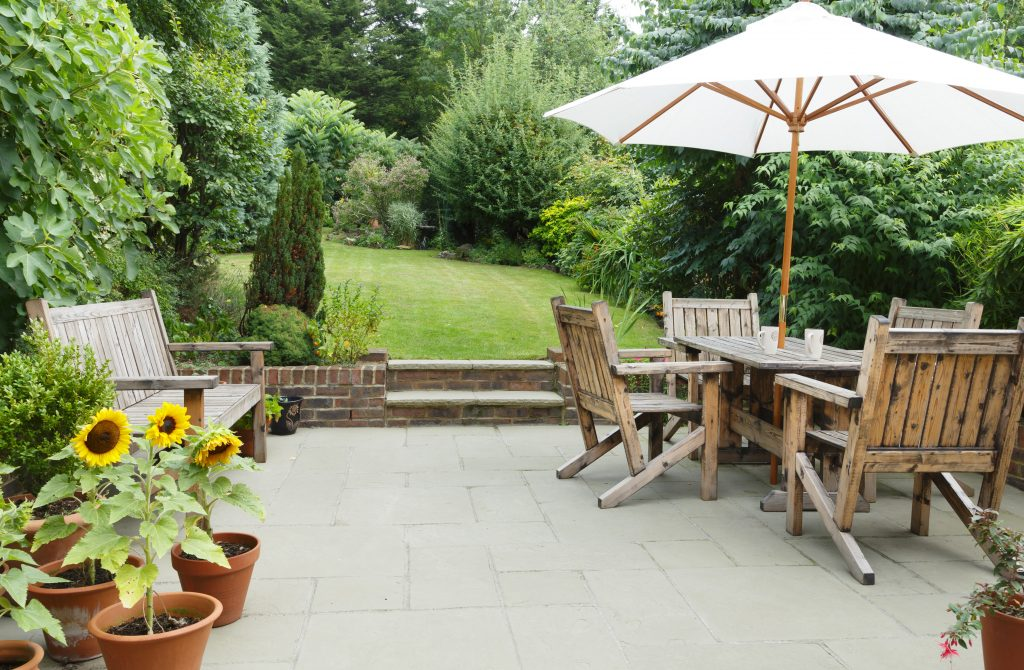 patio with concrete pavers and plants