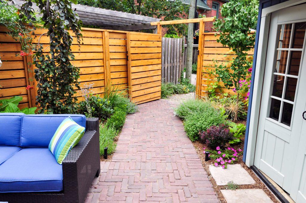 Elegant backyard garden with brick pavers