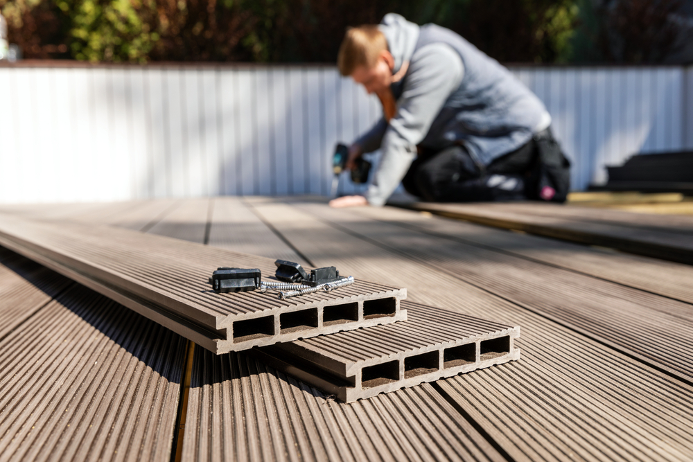 professional installing a patio with composite decking