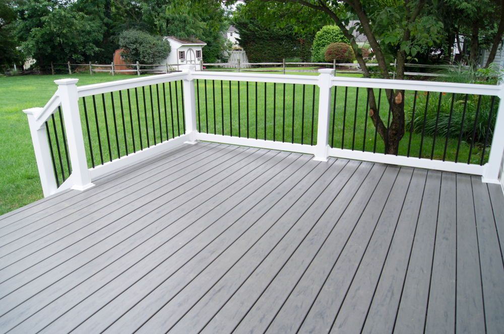 composite decking patio overlooking a lawn