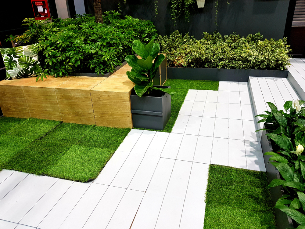 porcelain pavers crossing over a garden